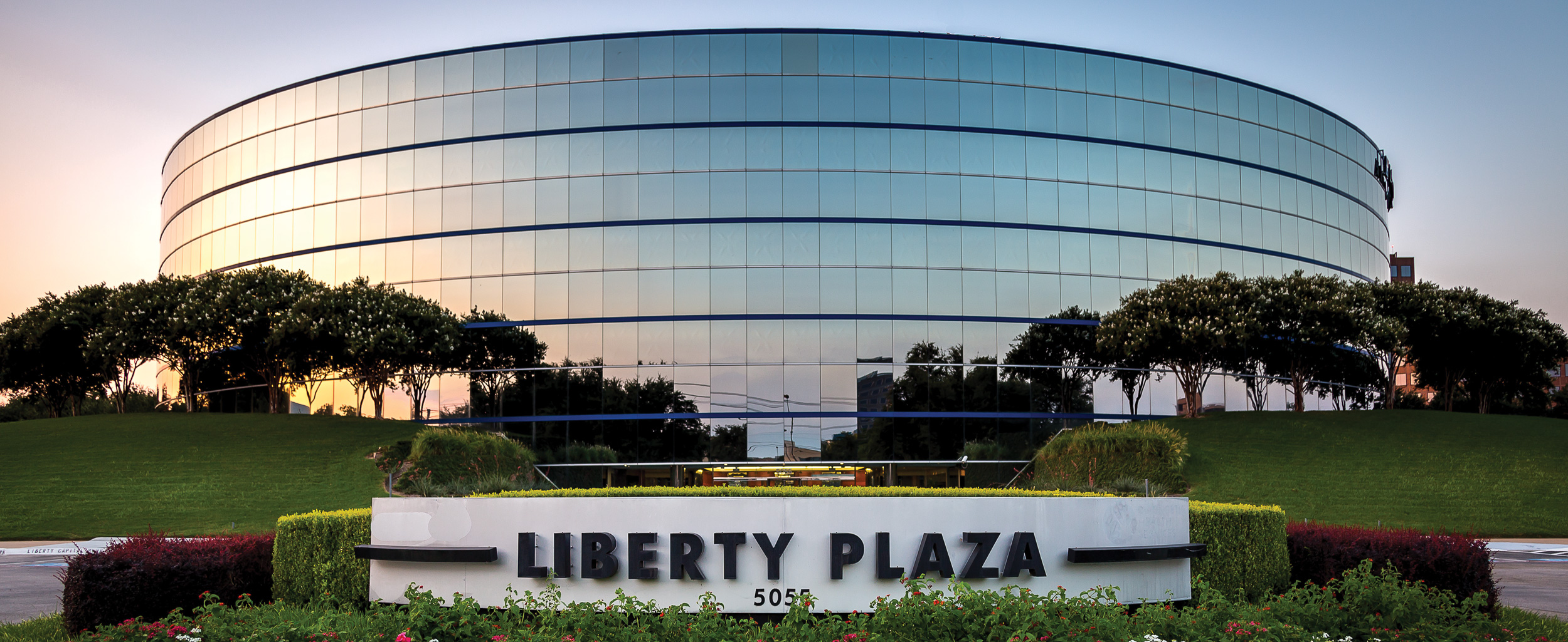 exterior of Liberty Capital Bank at sunset
