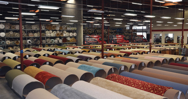 rolls of carpet in a mill warehouse
